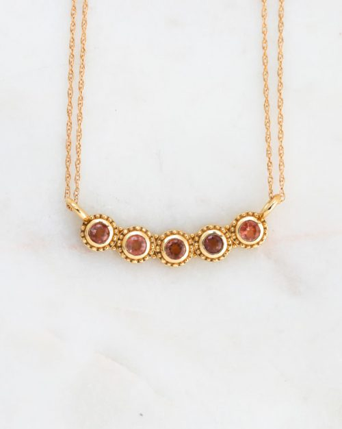 gold life necklace, sunstones, sapphires