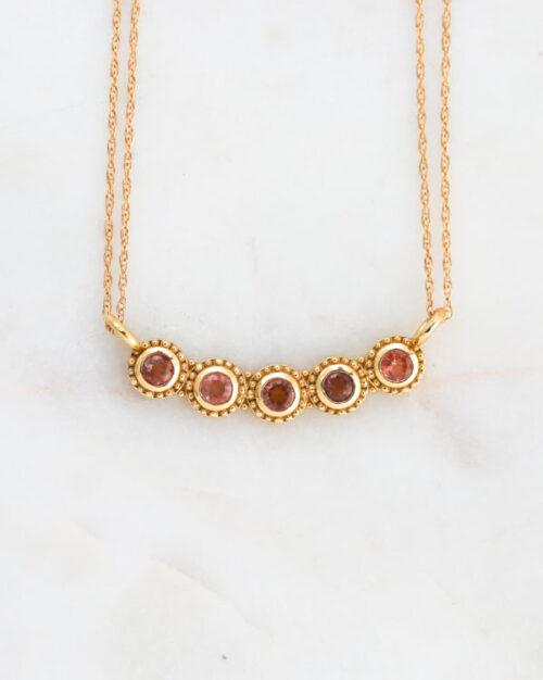 gold life necklace, sunstones, sapphires