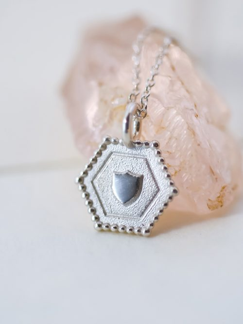 silver shield charm necklace